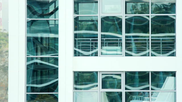 facade of a modern glass building in a moving elevator video