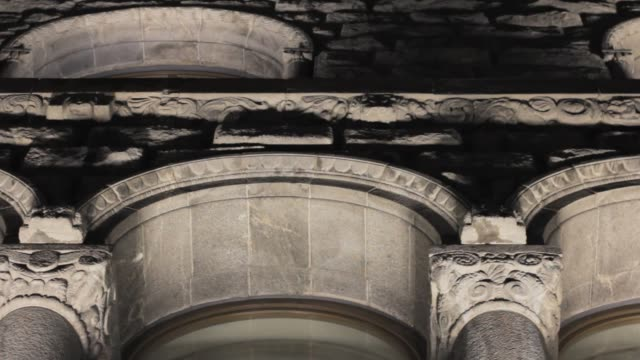 facade of a stone antique building. sculptures on the wall. stone texture