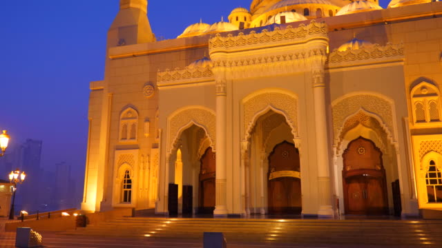 Facade of Al Noor Mosque in Sharjah Emirates. Night view illuminated building.