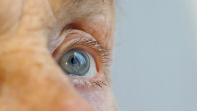 Face and eyes of elderly person, woman aged 81 years video