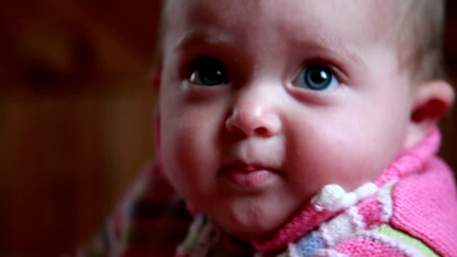 Face close-up of a restless baby video