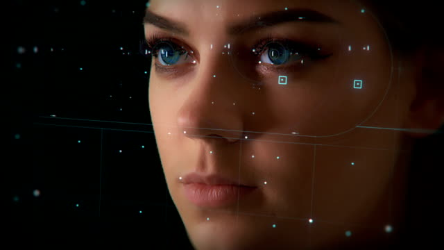 vídeos de stock e filmes b-roll de face id. facial recognition system. face detection dots and greed. futuristic and technological 3d scanning of the face of a beautiful woman for facial recognition. close up. - identidade