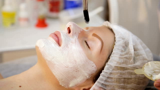 Face mask being applied during spa treatment video