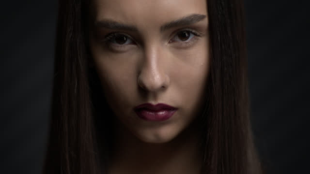 Face of a beautiful brunette girl. Make-Up. video