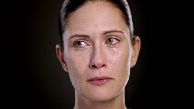 Face of a crying young Caucasian woman