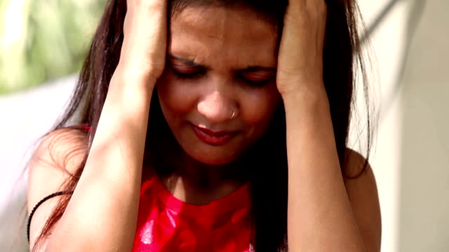 Face of a crying young of Indian ethnicity video