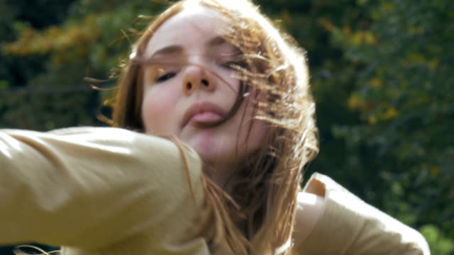 Face of a Girl Dancing The face of a girl dancing in a park filmed from close up. charming stock videos & royalty-free footage