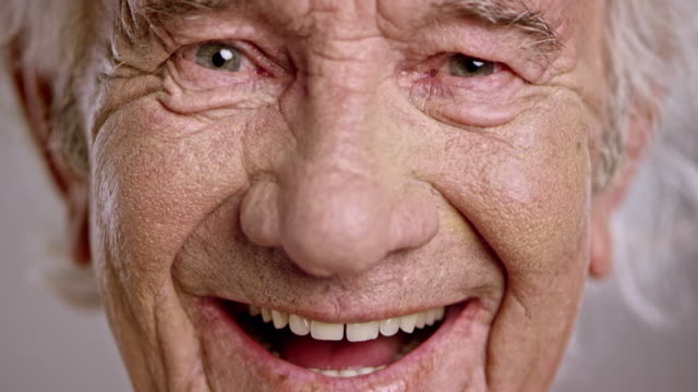 Face of a laughing senior Caucasian man video