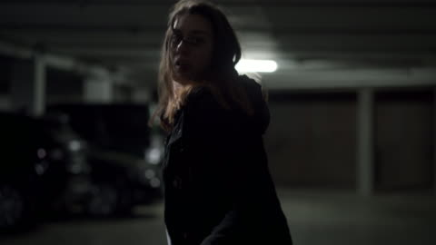 Face of fear Afraid teenage girl running away in a parking garage fear stock videos & royalty-free footage
