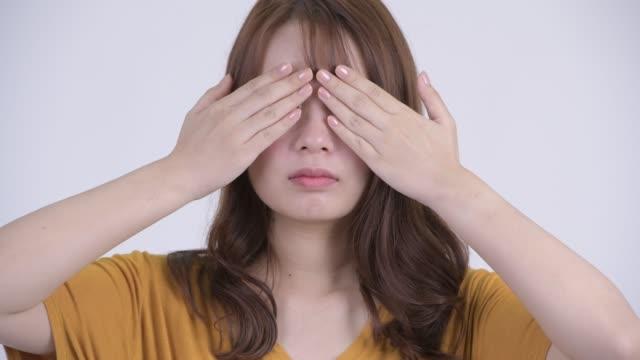 face of young beautiful asian woman - negacja filmów i materiałów b-roll