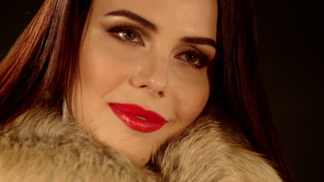 Face of young woman with makeup in coat with fur collar video