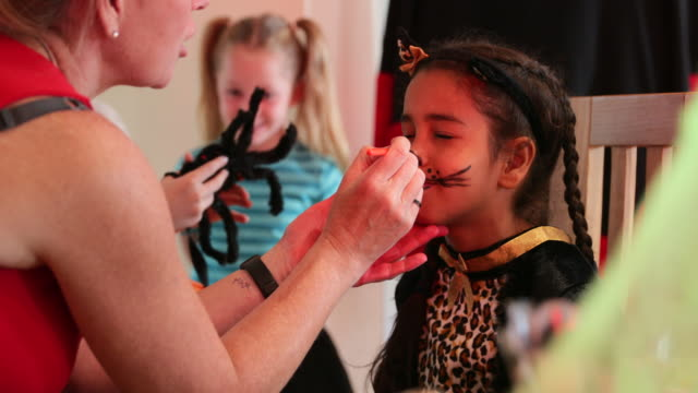 face painting session - halloween stock videos & royalty-free footage