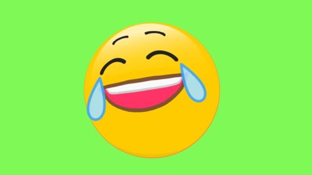 das gesicht mit tears of joy emoji - smiley stock-videos und b-roll-filmmaterial