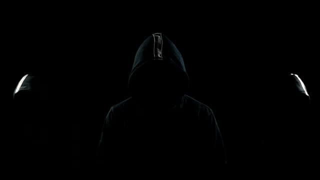 faceless men in the dark - penombra video stock e b–roll