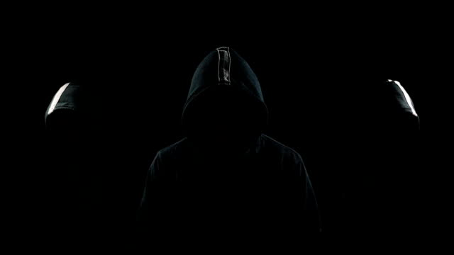 faceless mysterious hooded individuals - penombra video stock e b–roll