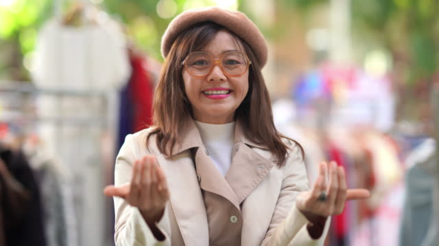 facial expression by Asian mature woman , beckoning  and welcome sign