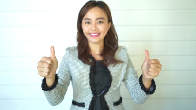 facial expression by Asian mature woman , good and success sign , thumbs up