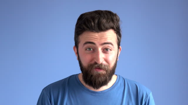 Facial Expression Of Happy Excited Man On Blue Background video