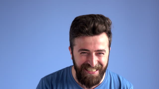 Facial Expression Of Happy Laughing Adult Man On Blue Background video