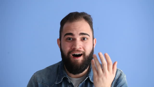 Facial Expression Of Surprised Adult Man On Blue Background video