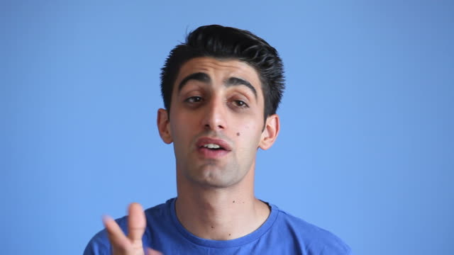 Facial Expression Of Talking Adult Man On Blue Background video
