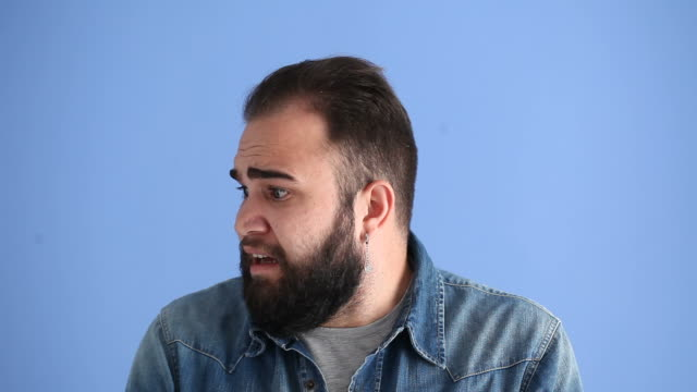 Facial Expression Of Terrified Adult Man On Blue Background video