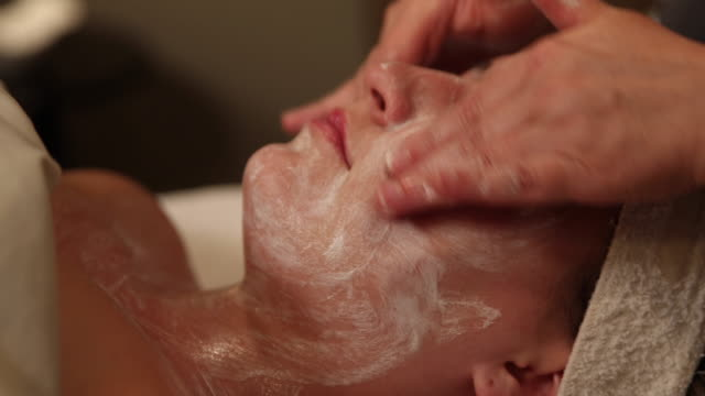 facial massage move in to face - facial stock videos & royalty-free footage