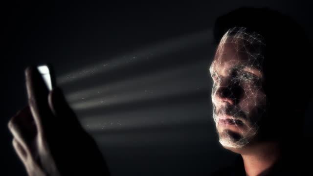 vídeos de stock e filmes b-roll de facial recognition concept with modern smartphone - proteção