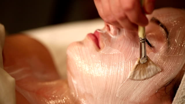 facial treatment with brush tilt up - spa facial stock videos & royalty-free footage