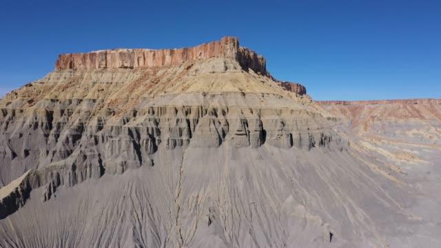 Factory Butte Of Steel Grey Mudstone Rocks Formation In Utah Desert Valley