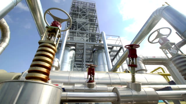 Factory distribution, and industrial processing of natural gas. Many pipelines and valves video