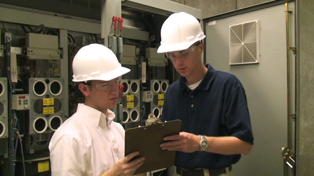 Factory Engineers Factory Engineers, or electricians or Inspector checking electrical circuits. futebol stock videos & royalty-free footage
