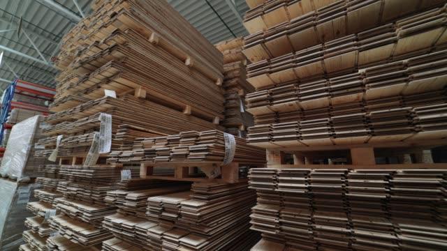 vídeos de stock e filmes b-roll de factory for the production of parquet board. - material de construção