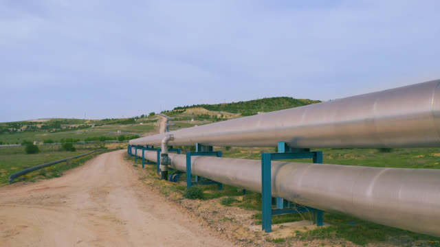 Factory Pipeline in Nature - Aerial View Big factory land and pipeline in nature gas pipe stock videos & royalty-free footage