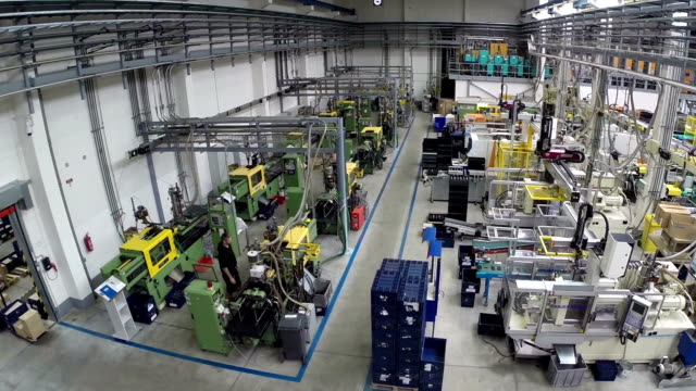 factory production Aerial view of production machinery in a factory warehouse aerial stock videos & royalty-free footage
