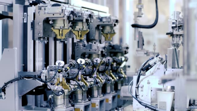 Factory Robot Arm In Manufacturing Assembling Line Product