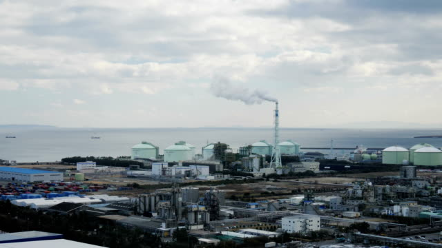 Factory with smoking chimney in industrial plant
