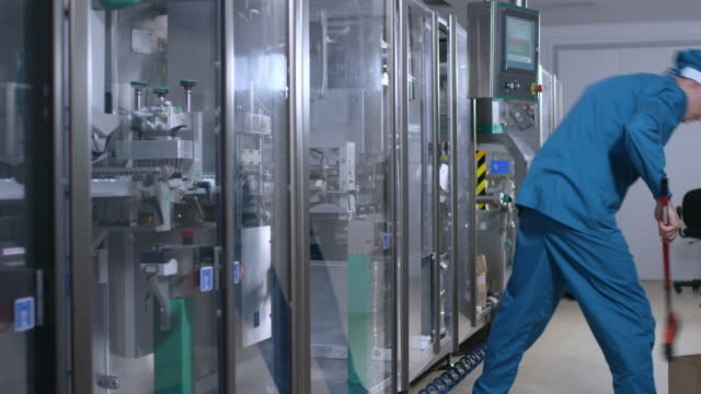 Factory worker sweep the floor. Factory interior cleaning service video
