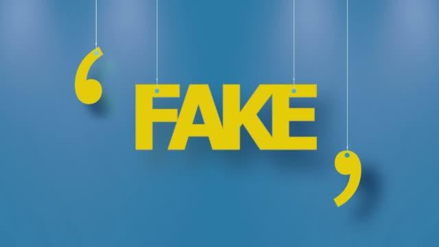 stockvideo's en b-roll-footage met fake tekst in geel opgehangen met strings op blauwe achtergrond in 4k-resolutie - bord bericht