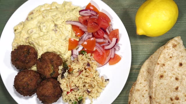 falafel with couscous hummus and salad - vegan stock videos and b-roll footage