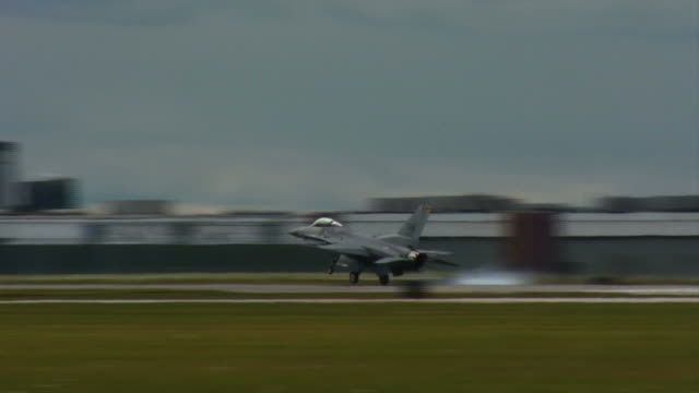 F-16 Falcon 04 landing USAF fighter plane landing on runway. airfield stock videos & royalty-free footage