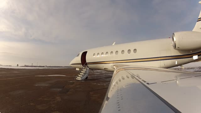 Falcon Business Jet closing aircraft door A Falcon 2000 Business Jet closing the aircraft door in St. Petersburg, Russia. private airplane stock videos & royalty-free footage