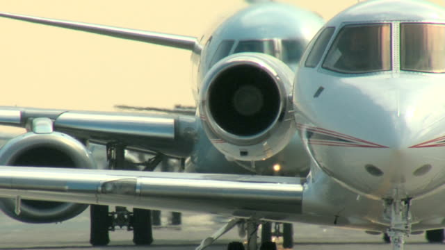 Falcon business jet Taxi - Airbus 320 airplane following video