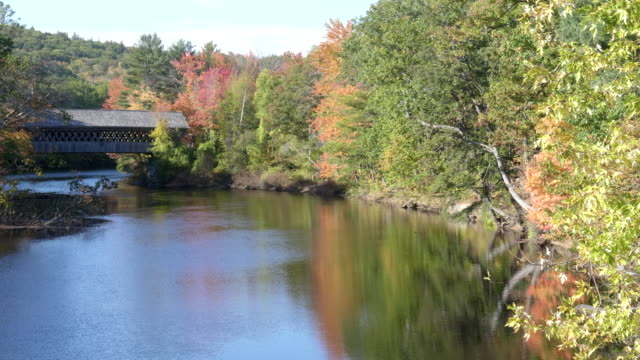 fall colors around the henniker covered bridge and the contoocook river