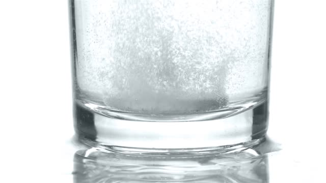 Falling a tablet in glass with water Falling a tablet in glass with water. Closeup tonic water stock videos & royalty-free footage