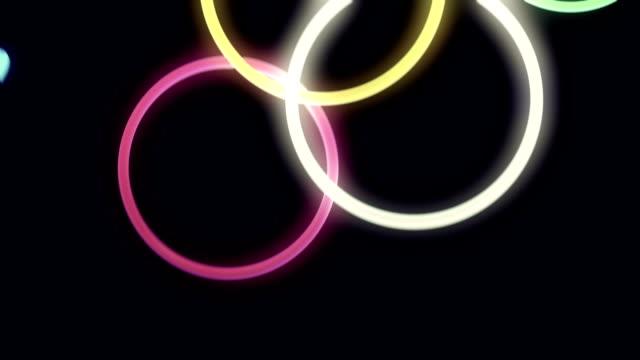 Falling, Bouncing Neon Rings in Slow Motion Loop video