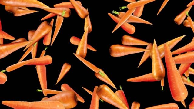 fallande morötter bakgrund, slinga grönsaker, med alfakanal, - morot bildbanksvideor och videomaterial från bakom kulisserna