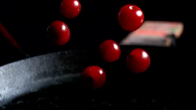 Falling cherries. Super slow motion video