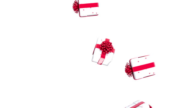 Falling Christmas gift boxes Falling Christmas gift boxes on white background, luma matte gifts stock videos & royalty-free footage
