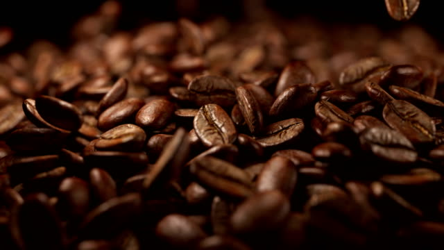 Falling coffee beans in 4k slow motion 1000fps video
